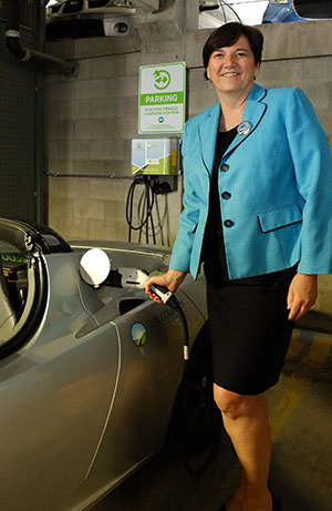 Mayor Sorensen plugs in car at Town's new electric vehicle charger